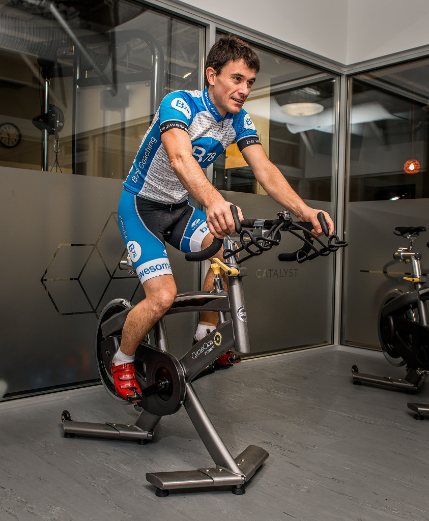 Jasper Blake coaches spin class at Catalyst