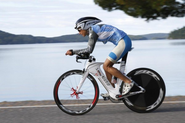 Christine Fletcher rides along the water during a triathlon