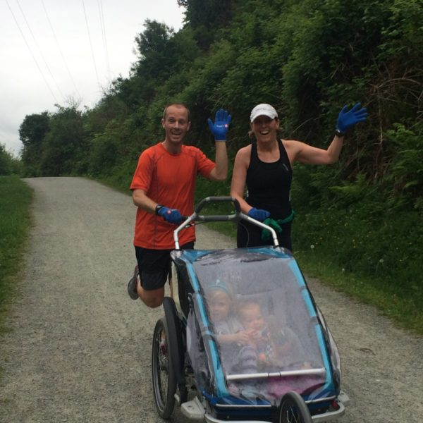 Kristina Rody running with husband and child in tow