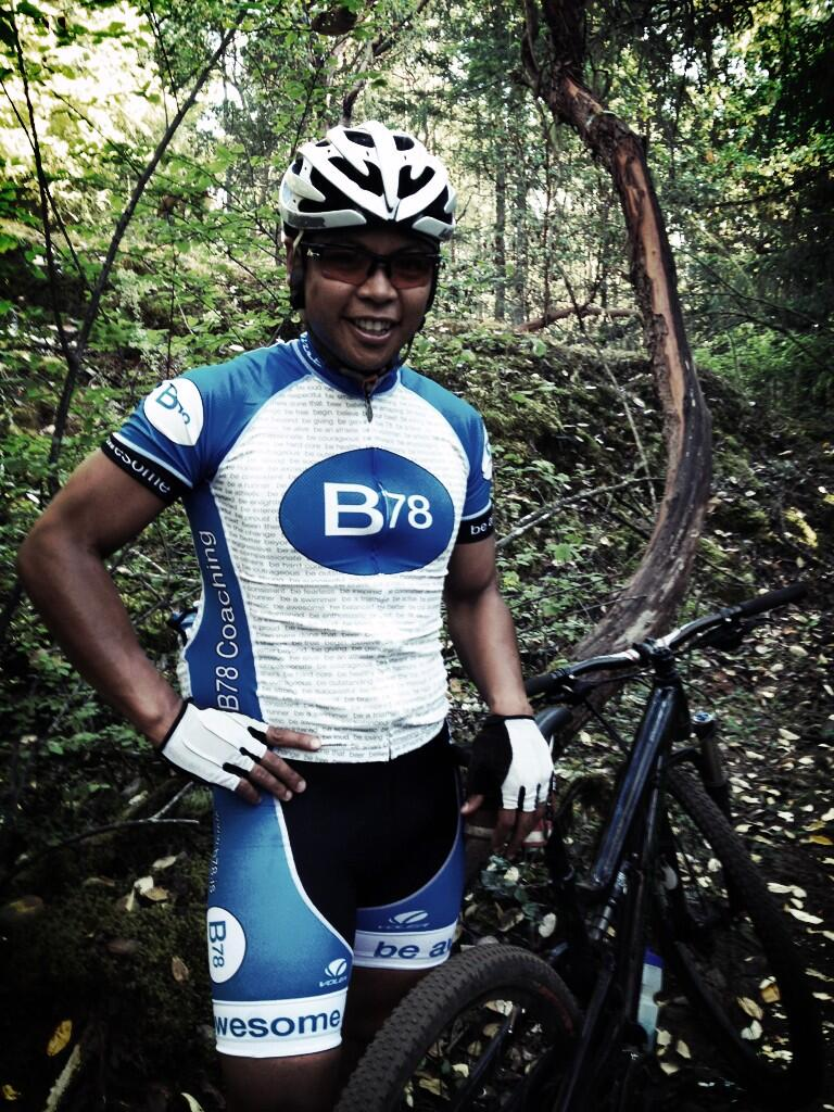 Tony Zarsadias standing in the forest with his bike, modelling our B78 cycling kit