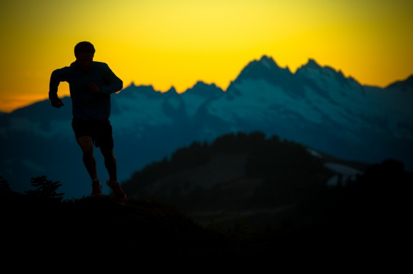 Adam Campbell running with sunset and mountains in the background