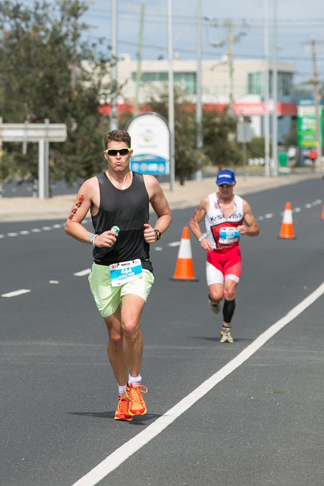 Travis Mackenzie runs in the sunshine on the last leg of a gruelling triathlon