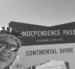 Colin Cameron cycling through Independence Pass