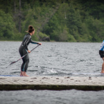 Steph and Jasper paddle boarding in Whistler, BC