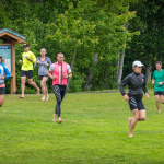 Ironman Canada Training Camp members running in circles