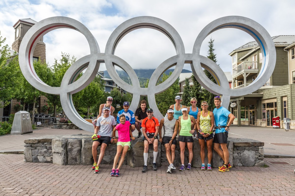Group shot of Ironman Canada athletes in front of Olympic rings