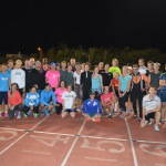 Group poses on the track at the Bermuda triathlon training camp