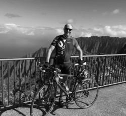 Cyclist Mike Carroll standing with his bike in Kalalau