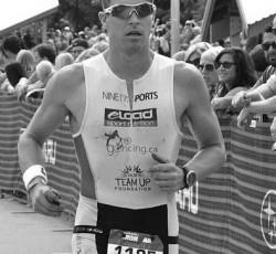 Triathlete Travis McKenzie running in Ironman Canada