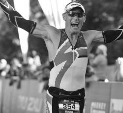 exuberant doug hahn crossing the finish line at ironman canada