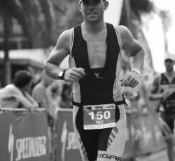 nic ticker running down finisher chute at IM Cairns