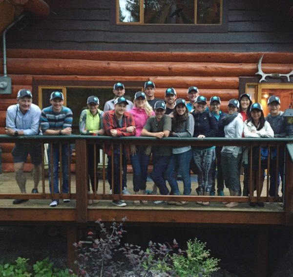 Athletes infront of cabin at camp whistler training for ironman