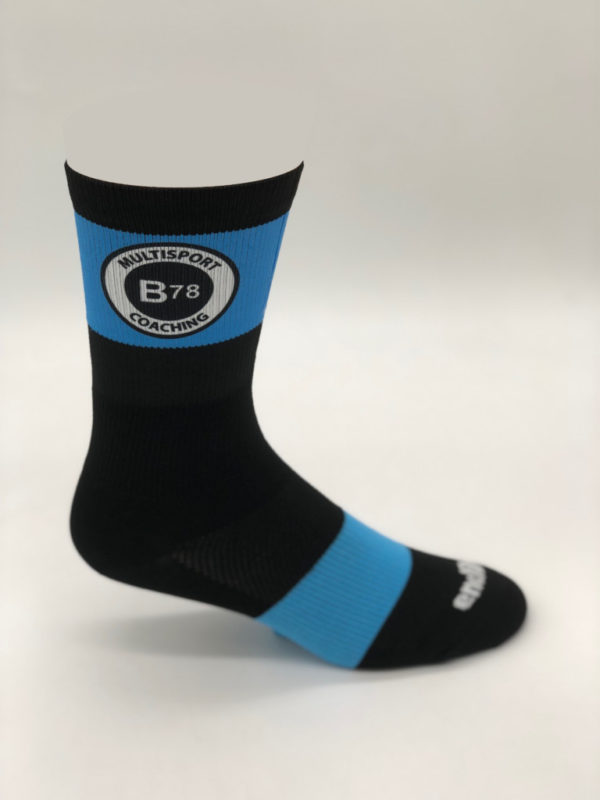 A profile of a black and Blue B78 athletic sock.