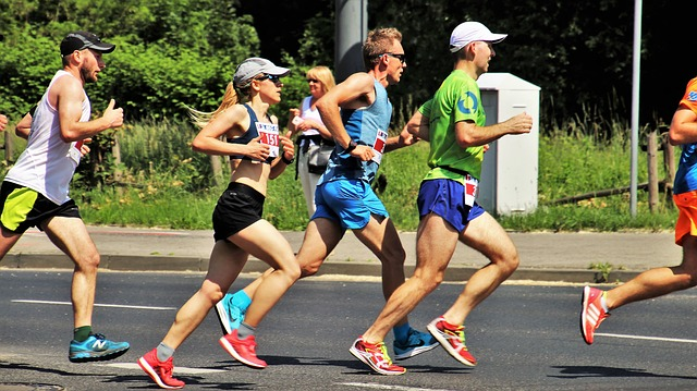 Athletes running on a road during a marathon event